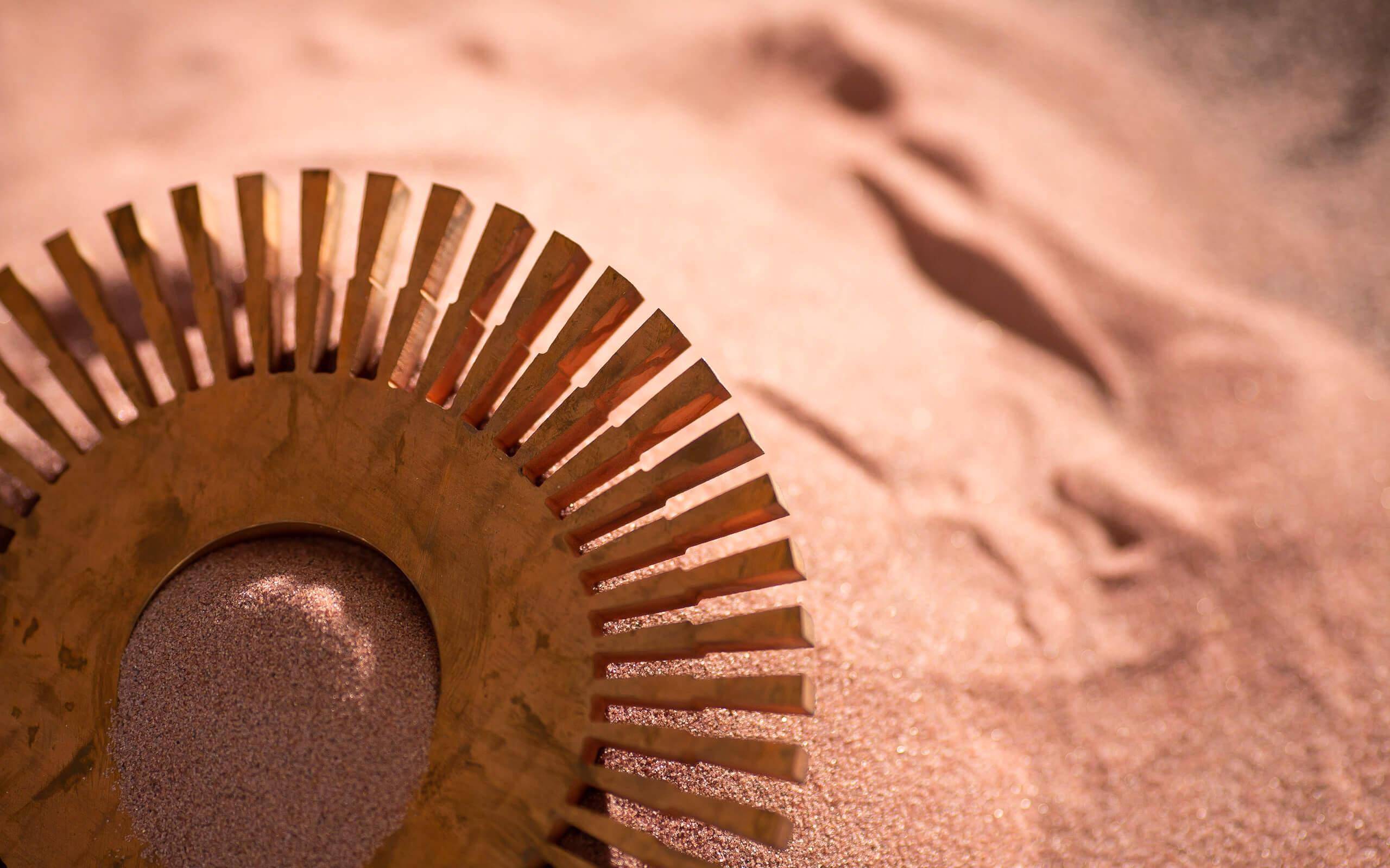 Chemikalien kaufen, Sand mit Runder Metalscheibe aus Gold