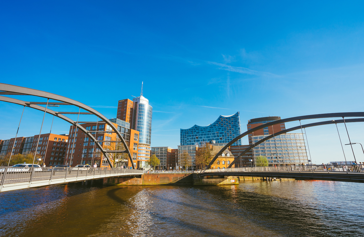 Food Ingredients Company, HafenCity, Speicherstadt: Panoramic view in front of the modern Elbphilharmonie building with Niederbaumbrucke Bridges in foreground